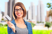 Young cool woman with a credit card — Stock Photo