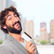 Young crazy man with a credit card — Stock Photo #65687291
