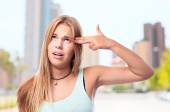 Young cool woman suicide sign — Stock Photo