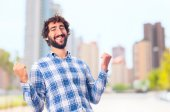 Young man celebrating gesture — Stock Photo