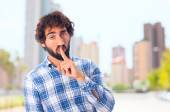 Young man silence gesture — Stock Photo