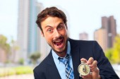 Young crazy businessman shouting with a timer — Stock Photo