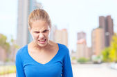 Young cool woman angry pose — Stock Photo