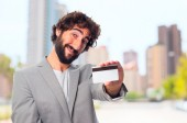 Young crazy man with a credit card — Stock Photo