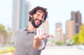 Young crazy man with a dice. luck concept — Stock Photo