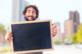 Young crazy man showing a blackboard — Stock Photo
