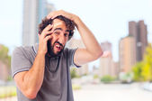 Young crazy man with head pain — Stock Photo