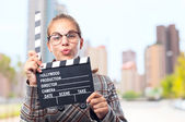 Young cool woman with a clapperboard — Stock Photo