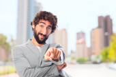 Young crazy man pointing — Stock Photo
