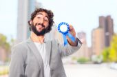 Young crazy man with a medal — Foto de Stock