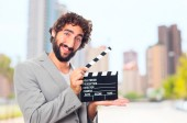 Young crazy manwith a clapperboard — Stock Photo