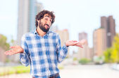 Young doubtful mad — Stock Photo
