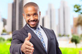 Young cool black man confidence shake hands — Stock Photo