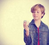 Dreamer boy holding a die — Stock Photo