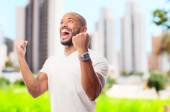 Young cool black man celebratin sign — Stock Photo