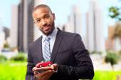 Young cool black man with car toy — Stock Photo