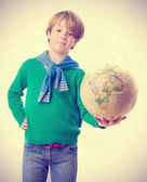Pleased child holding a world globe — Stock Photo