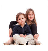 Young boy and girl posing — Stock Photo