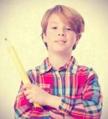 Proud kid holding a pencil — Stock Photo