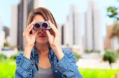 Young cool woman with bonoculars — Stock Photo