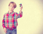 Doubtful child trying to solve a problem — Stock Photo