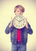 Boy holding a clock — Stock Photo