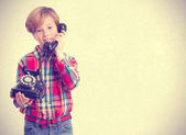 Child answering to the phone — Stock Photo
