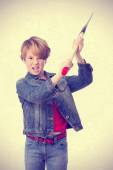 Angry child with an ax — Stock Photo