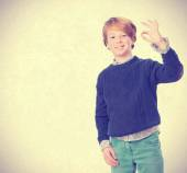 Child with approval gesture — Stock Photo