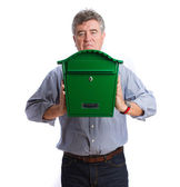 Happy man holding a postbox — Stock Photo