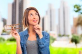 Young cool woman with wooden plane — Stockfoto