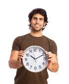 Hindu cool young man with a clock — Stock Photo