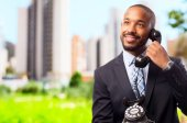 Young cool black man speaking at telephone — Stock Photo