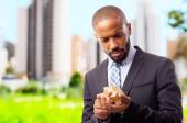 Young cool black man solving a problem — Stock Photo