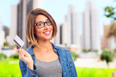 Young cool woman with credit card — Stock Photo