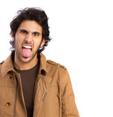 Hindu cool young man showing toungue — Stock Photo