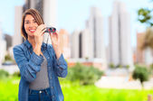 Young cool woman with binoculars — Stock Photo