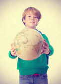Happy child holding a world globe — Stock Photo