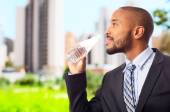 Young cool black man drinking water — Stock Photo