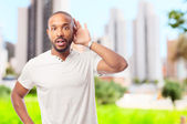 Young cool black man trying to listen — Stock Photo