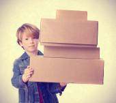 Troubled child holding a cardboard boxes — Stock Photo