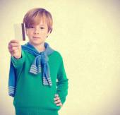 Child who offers to pay by credit card — Stock Photo