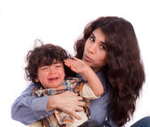 Mother soothing her pissed child — Stock Photo