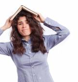 Concerned student with a book on her head — Stock Photo