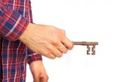 Hindu cool young man opening with a key — Stock Photo