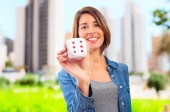 Young cool woman with a dice — Stock Photo