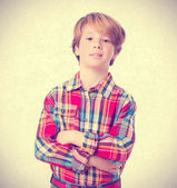Pensive boy with arms crossed — Stock Photo