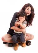 Mother holding her naughty son — Stock Photo