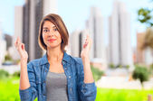 Young cool woman finger crossing — Stock Photo