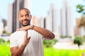 Young cool black man tie out sign — Stock Photo